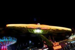 Δίκαιη ρόδα πορθμείων καρναβαλιού στην ταχύτητα Στοκ Φωτογραφίες