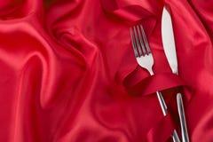 Δίκρανο και μαχαίρι με την κορδέλλα Στοκ Εικόνες