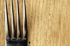 Δίκρανο στον πίνακα κουζινών Στοκ Εικόνα