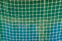 Δίκτυο σχοινιών με τους κόμβους και τετραγωνικά κύτταρα με το υπόβαθρο Στοκ φωτογραφία με δικαίωμα ελεύθερης χρήσης