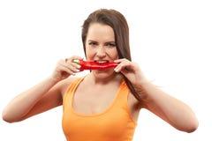 Δαγκώνοντας γλυκό πιπέρι στοκ φωτογραφία με δικαίωμα ελεύθερης χρήσης