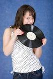 δαγκώνοντας μπλε αρχείο φωνογράφων κοριτσιών στοκ φωτογραφίες με δικαίωμα ελεύθερης χρήσης