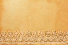 Δαντέλλα σε παλαιό χαρτί Στοκ εικόνα με δικαίωμα ελεύθερης χρήσης