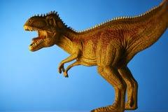 Δεινόσαυρος στο μπλε υπόβαθρο Στοκ Εικόνες