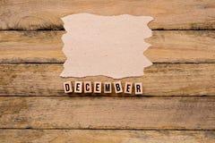 Δεκέμβριος - ημερολογιακός μήνας στα ξύλινα κεφαλαία γράμματα με χειροποίητο στοκ εικόνες με δικαίωμα ελεύθερης χρήσης