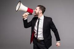 Δευτερεύον επιχειρησιακό άτομο πορτρέτου που κραυγάζει με megaphone Στοκ Εικόνα