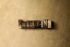 ΔΗΜΙΟΥΡΓΙΑ - κινηματογράφηση σε πρώτο πλάνο της βρώμικης στοιχειοθετημένης τρύγος λέξης στο σκηνικό μετάλλων Στοκ φωτογραφία με δικαίωμα ελεύθερης χρήσης