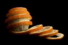 Δημιουργική πορτοκαλιά αποφλοίωση πέρα από το μαύρο υπόβαθρο Στοκ εικόνα με δικαίωμα ελεύθερης χρήσης