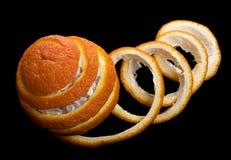 Δημιουργική πορτοκαλιά αποφλοίωση πέρα από το μαύρο υπόβαθρο Στοκ φωτογραφίες με δικαίωμα ελεύθερης χρήσης
