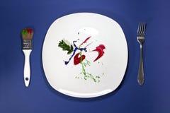 Πιάτο με το δίκρανο και το πινέλο Στοκ Φωτογραφία