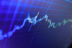 Διάγραμμα χρηματιστηρίου, γραφική παράσταση στο μπλε υπόβαθρο Εμπορικές συναλλαγές επένδυσης χρηματιστηρίου χρηματοδότησης Στοκ Εικόνα