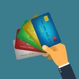 Διάνυσμα πιστωτικών καρτών εκμετάλλευσης χεριών Στοκ εικόνες με δικαίωμα ελεύθερης χρήσης