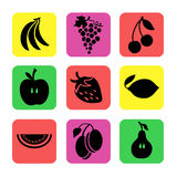 Διάφορα φρούτα σε ένα υπόβαθρο χρώματος Στοκ Φωτογραφίες