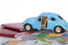 Διαβατήριο, αυτοκίνητο παιχνιδιών και παγκόσμιος χάρτης Στοκ εικόνα με δικαίωμα ελεύθερης χρήσης