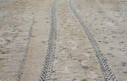 Διαδρομές ροδών στην άμμο Στοκ εικόνες με δικαίωμα ελεύθερης χρήσης