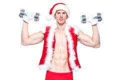 Διακοπές και εορτασμοί, νέο έτος, Χριστούγεννα, αθλητισμός, υγιής τρόπος ζωής - μυϊκός όμορφος Άγιος Βασίλης Στοκ εικόνες με δικαίωμα ελεύθερης χρήσης