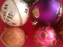 Διακοσμήσεις παιχνιδιών Χριστουγέννων υποβάθρου Στοκ Εικόνες