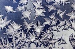 Διακοσμήσεις σε ένα παγωμένο παράθυρο όπως τον αστερία 4 Στοκ Φωτογραφίες