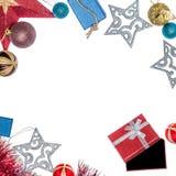 Διακοσμήσεις Χριστουγέννων - μπιχλιμπίδια, αστέρια Χριστουγέννων και δώρα Στοκ Εικόνες