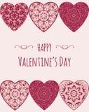 Διακοσμητική ευχετήρια κάρτα βαλεντίνων με τις floral περίκομψες καρδιές Απεικόνιση αποθεμάτων