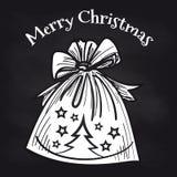 Διακοσμητική τσάντα Χριστουγέννων στον πίνακα κιμωλίας απεικόνιση αποθεμάτων