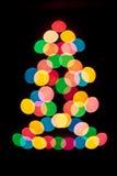 Διακοσμητικός πολύχρωμος φωτισμός στο χριστουγεννιάτικο δέντρο Στοκ εικόνα με δικαίωμα ελεύθερης χρήσης