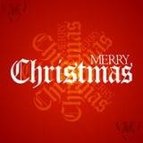 Διακοσμητικό κείμενο Χριστουγέννων στο κατασκευασμένο κόκκινο υπόβαθρο Στοκ Φωτογραφίες