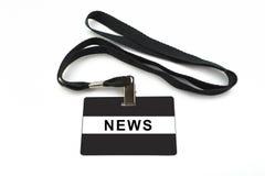 Διακριτικό ειδήσεων στο άσπρο υπόβαθρο Στοκ Εικόνα