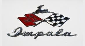 Διακριτικό Impala Chevrolet και χειρόγραφο χρωμίου Στοκ Εικόνα