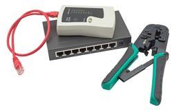 Διακόπτης δικτύων, ethernet καλώδιο, crimper και RJ45 ελεγκτής καλωδίων Στοκ Εικόνες