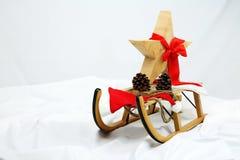 Διακόσμηση αστεριών Χριστουγέννων με το κόκκινο τόξο στοκ φωτογραφία