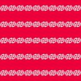 Διακόσμηση σε μια κόκκινη ανασκόπηση Στοκ φωτογραφία με δικαίωμα ελεύθερης χρήσης