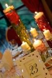 Διακόσμηση των λουλουδιών και των κεριών νερού Στοκ Φωτογραφία
