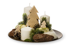 Διακόσμηση Χριστουγέννων - η σύνθεση Χριστουγέννων έκανε τα κεριά και τα διακοσμητικά εξαρτήματα Χριστουγέννων που απομονώθηκαν α Στοκ Φωτογραφίες