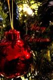Διακόσμηση Χριστουγέννων (κινηματογράφηση σε πρώτο πλάνο) 1 - λέει τη Χαρούμενα Χριστούγεννα - κόκκινο Στοκ Εικόνα