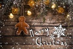 Διακόσμηση Χριστουγέννων στην ξύλινη ανασκόπηση στοκ εικόνα