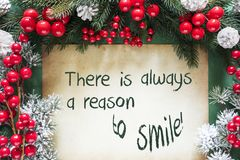 Διακόσμηση Χριστουγέννων όπως τον κλάδο δέντρων του FIR, χαμόγελο λόγου αποσπάσματος πάντα στοκ φωτογραφία