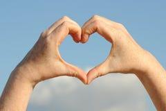 Διαμορφωμένα καρδιά χέρια Στοκ Εικόνες