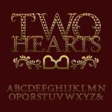 Διαμορφωμένες χρυσός επιστολές με τα tendrils Εκλεκτής ποιότητας ρομαντική πηγή Στοκ εικόνα με δικαίωμα ελεύθερης χρήσης
