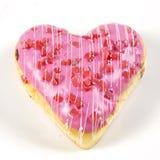 Διαμορφωμένη καρδιά doughnut φράουλα Στοκ Φωτογραφία