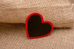 Διαμορφωμένο καρδιά αντικείμενο στον καμβά στοκ φωτογραφία