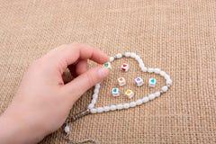 Διαμορφωμένο καρδιά αντικείμενο υπό εξέταση στοκ φωτογραφία με δικαίωμα ελεύθερης χρήσης
