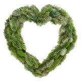 Διαμορφωμένο καρδιά φυσικό στεφάνι Χριστουγέννων Στοκ φωτογραφίες με δικαίωμα ελεύθερης χρήσης