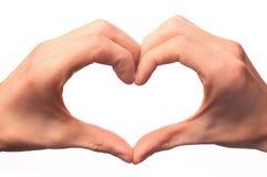 διαμόρφωση του ανθρώπινου συμβόλου αγάπης χεριών στοκ εικόνες