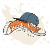 Διανυσματική απεικόνιση με τα πάνινα παπούτσια και το καπέλο του μπέιζμπολ Στοκ φωτογραφίες με δικαίωμα ελεύθερης χρήσης