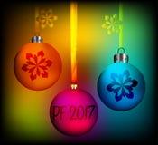 Διανυσματική ευχετήρια κάρτα με την επιγραφή pf 2017 και μερικές χρωματισμένες σφαίρες Χριστουγέννων Στοκ Εικόνα