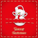 Διανυσματικό έμβλημα: χαριτωμένος χιονάνθρωπος ειδωλίων στην τσέπη τζιν και συρμένη τη χέρι Χαρούμενα Χριστούγεννα κειμένων Στοκ Εικόνα