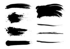 Διανυσματικό σύνολο συρμένων χέρι κτυπημάτων βουρτσών, λεκέδες για τα σκηνικά Μονοχρωματικά στοιχεία σχεδίου καθορισμένα Ένα μονο ελεύθερη απεικόνιση δικαιώματος