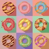 Διανυσματικό σύνολο εννέα νόστιμων ζωηρόχρωμων εικονιδίων donuts Στοκ εικόνα με δικαίωμα ελεύθερης χρήσης