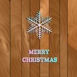 Διανυσματικό snowflake Χριστουγέννων της Λευκής Βίβλου σε ένα ξύλινο υπόβαθρο Στοκ Εικόνα